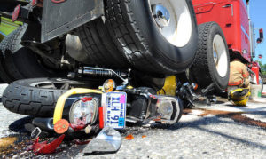 A truck ran over a 1991 Harley-Davidson Sportster on Main Street in Lewiston in July 2012. The driver of the motorcycle managed to kick away from the bike before it was crushed.